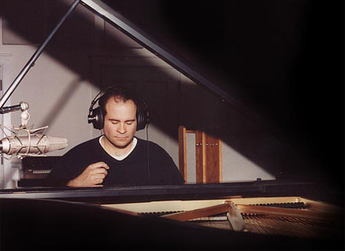 Joseph Bertolozzi in the studio at the piano. Image © 2002, Rennie Pomatti