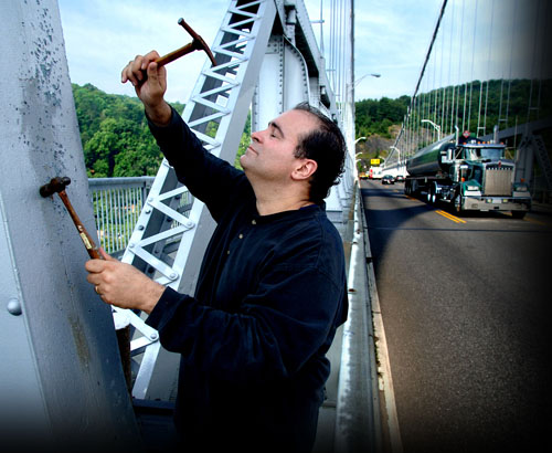 Composer Joseph Bertolozzi playing the Mid Hudson Bridge. Photo: © 2006, Spenser Ainsley for the Poughkeepsie Journal