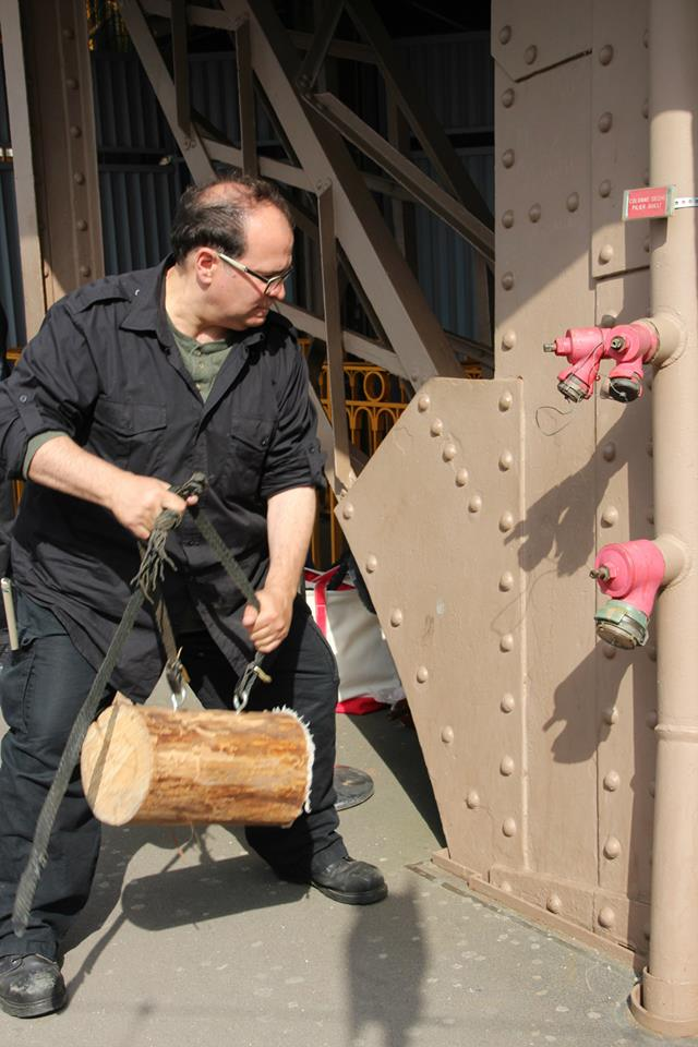 Joseph Bertolozzi at the Eiffel Tower with log mallet